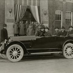 Japanese businessmen and U. S. Army members in front of the Nash main office