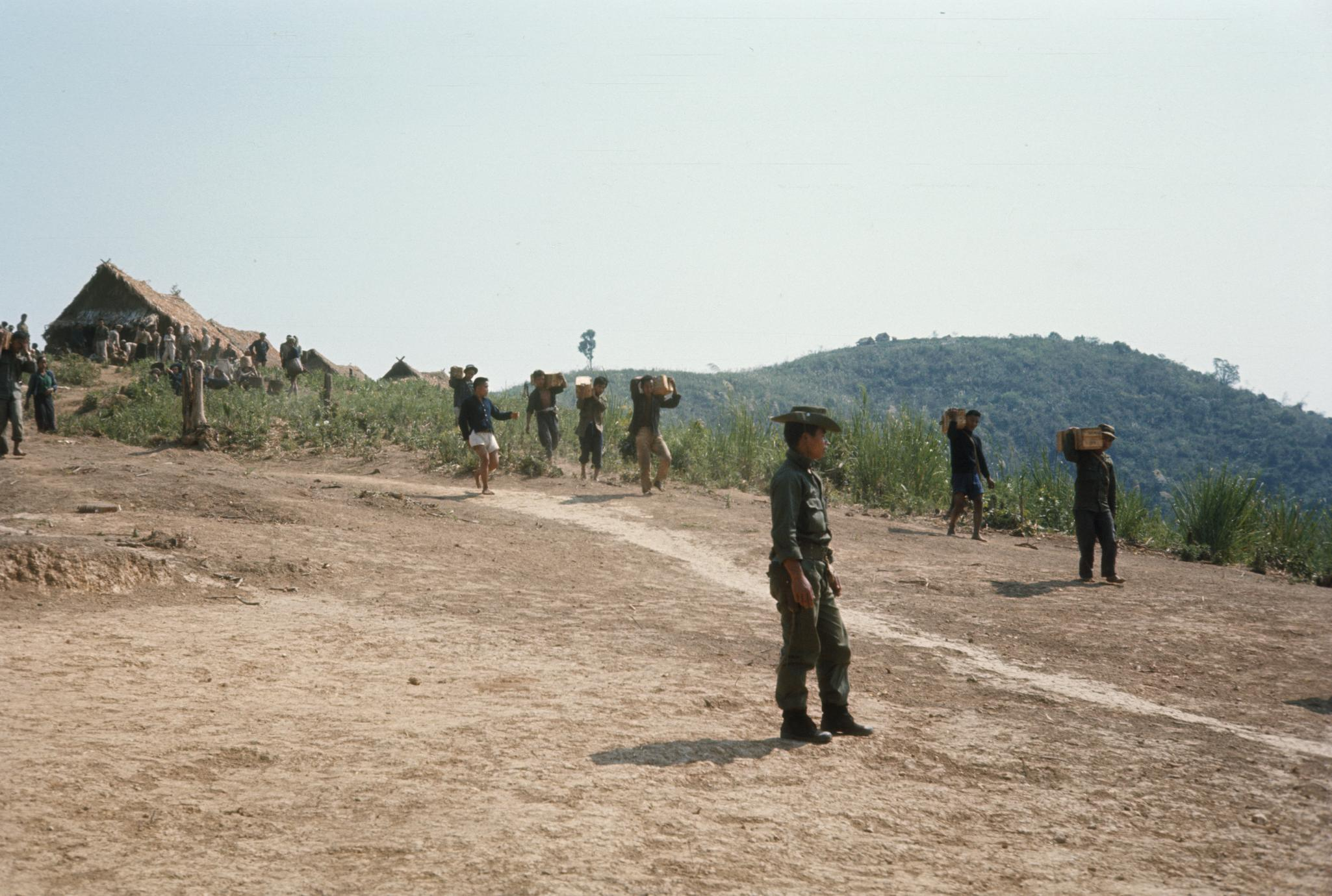 Men carrying ammunition