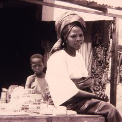 Mrs. Oluyemi sitting at a market stand