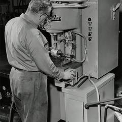American Motors Corporation factory employee at work