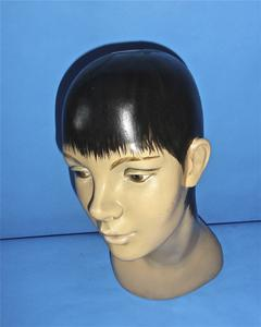 Plaster head with painted black pixie hair