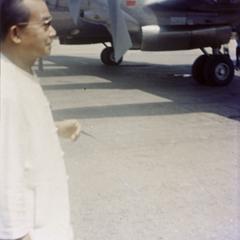 Prince Souvanna Phouma stands on the tarmac of Luang Prabang airport