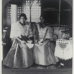 Two school girls in traditional dress, 1907