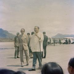 Prince Souvanna Phouma and Ouday Souvannavong await the arrival of Prince Souphanouvong at the Luang Prabang airport