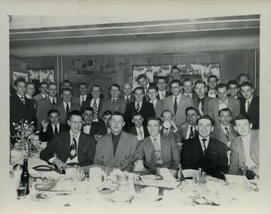 Sigma Tau Gamma group photograph at dinner
