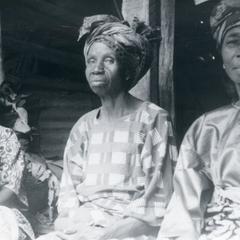 Three women selling kola