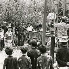 Villagers watch a new well being drilled in Houa Khong Province