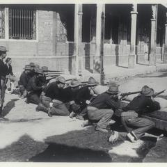 U.S. soldiers preparing to fire their rifles, Manila, early 1900s