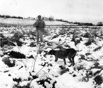 Hunting with his dog, Gus, near the Shack, November 1943 (in snow)