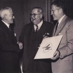 Commemoration photograph of the forming of American Motors Corporation