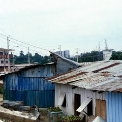 Shantytown with Downtown High Rise Buildings in Background