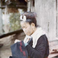A Blue Hmong (Hmong Njua) woman embroidering in northern Thailand