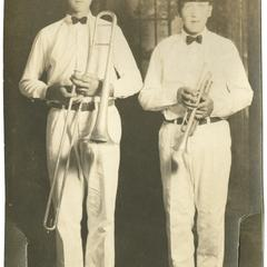Two men with brass instruments