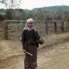 A Nyaheun woman walks to her fields in Attapu Province