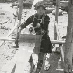 Akha woman weaving in the village of Phate in Houa Khong Province