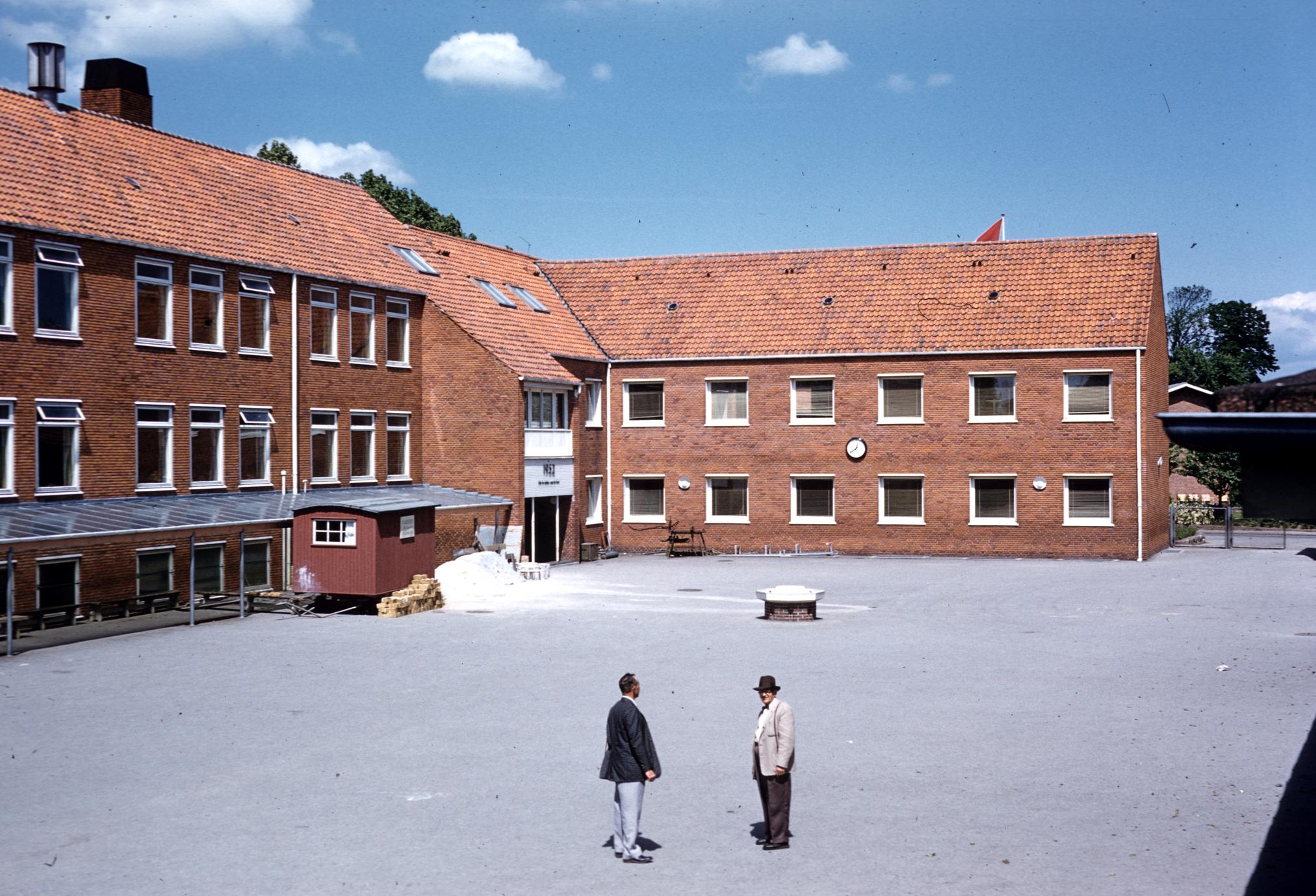 Men in front of a Danish school