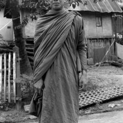 Monk with his alms bowl in carrying sack