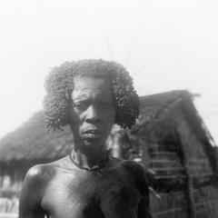 Kuba-Mbegi Upper Body Scarification and Hair Styled with Redwood Paste