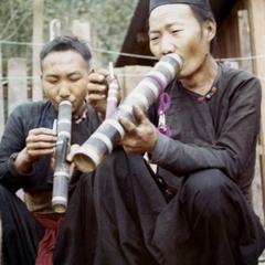 Two Blue Hmong (Hmong Njua) men smoking water pipes in northern Thailand