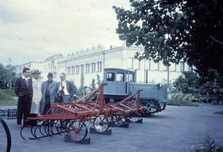 Men with agricultural equipment