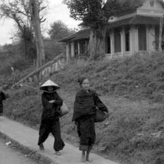 Vietnamese and Lao women on way to morning market