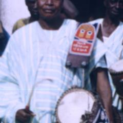 Man standing with drum during Iwude procession