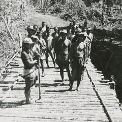 Villagers construct a bridge in Houei Kong Cluster in Attapu Province