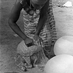 Woman Working Clay of Rounded Pot