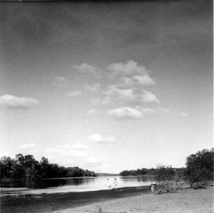 Aldo Leopold and unidentified person swimming in river