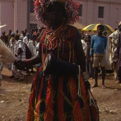Person in traditional dress during the Iwude festival