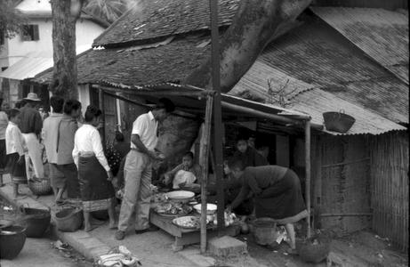 Lao women selling prepared food in shed