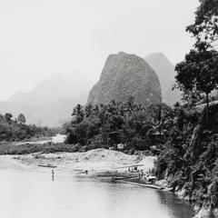 View of the karst mountains surrounding the town of Vang Vieng with the Nam Xong River in the foreground in Vientiane Province