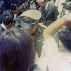 Prince Souphanouvong walks through the crowds with Phoumi Vongvichit and Prince Souvanna Phouma