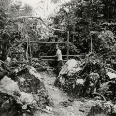 Jean Habert, photographer and French volunteer, enters the territory of a Yao village in the vicinity of Muang Vang Vieng in Vientiane province