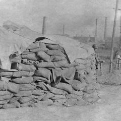 Japanese soldiers frisking Chinese traveler.