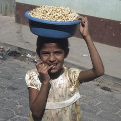 Local girl with kernels of boiled corn, Chiquimula
