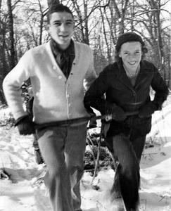 Starker and Betty Leopold walking on slough in winter