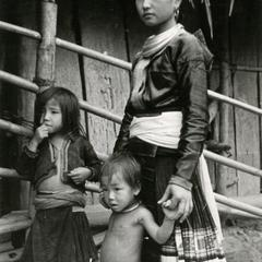 A Blue Hmong (Hmong Njua) mother and her children pose in a village in the area of Muang Vang Vieng in Vientiane Province