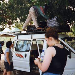 Man adjusts cargo on van
