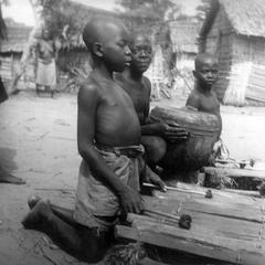 Young Kuba-Bushong Boys Practicing with Xylophone and Drum