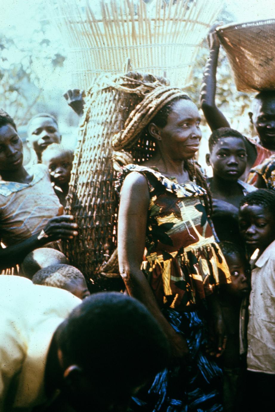 Dinga Woman with Basket on Back