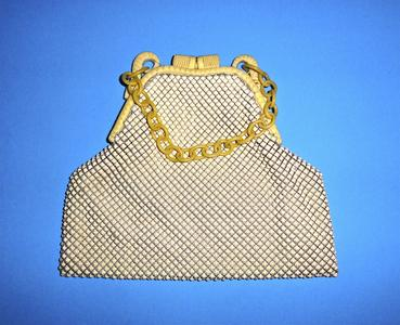 Whiting & Davis white alumesh bag with a carved celluloid frame