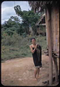 Lao girl carrying water