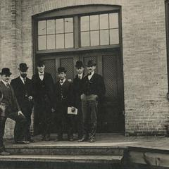 Chicago Brass Company employees outside the machine shop