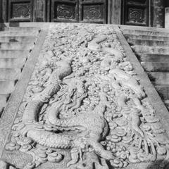 An imperial pavement in the center of stone steps.