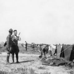 Two soldiers of the US Army's 15th Infantry Regiment talking in front of tents.