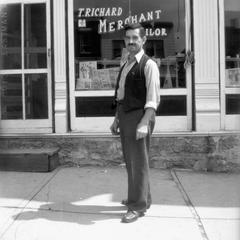Man at T. Richard Merchant Tailor Shop