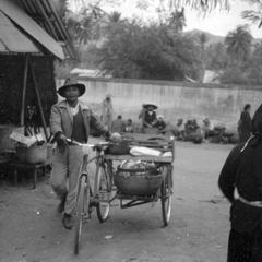 Samlaw driver, cart loaded with produce
