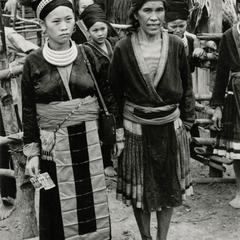Two Hmong women stand in a Hmong village in the vicinity of Muang Vang Vieng in Vientiane Province