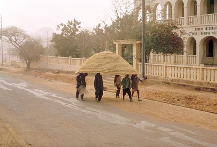 Men Carrying a Roof to a House